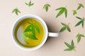 Cannabis herbal tea and marijuana leaves Royalty Free Stock Photo