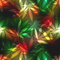 Cannabis leafs on blur rastafarian background seamless pattern Royalty Free Stock Photo
