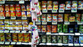 Canned food assorted supermarket department Stock Images