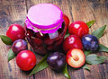 Canned and fresh plums Royalty Free Stock Images