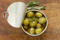 Canned green olives with rosemary