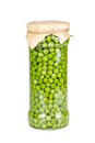 Canned green peas in glass jar isolated on white background Stock Photography