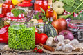 Canned peas with different fruits and vegetables in the background Stock Photography