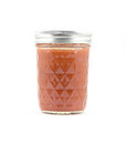 Canned red sauce in a glass jar Royalty Free Stock Photo
