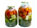 Canned tomatoes and cucumbers in a glass jar Royalty Free Stock Photo