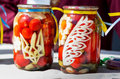 Canned tomatoes with ukrainian national symbols zaporizhia ukraine september family festival of homemade pickled vegetables and Royalty Free Stock Images