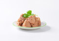 Canned tuna chunks of on white plate Royalty Free Stock Photos