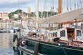 Cannes harbor with fortress and sailing ships in france Stock Image