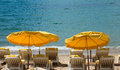 Cannes lounge chairs and parasol on the beach southern france Stock Image
