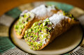 Cannoli with pistachio sicilian pastry desserts Stock Images
