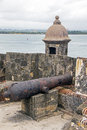 Cannon and a sentry box sea view from san felipe el morro fort in old san juan puerto rico Stock Photos