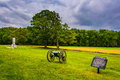 Cannon and sign in a field in Gettysburg, Pennsylvania. Royalty Free Stock Photo