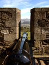Cannon on sterling castle black between battlement of looking out stirling town scotland Royalty Free Stock Photography