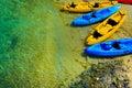 Canoe boats on a sunny beach Royalty Free Stock Photos