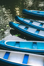 Canoe boats waiting for tourist hire on the lake in municipal city park. Hamburg Royalty Free Stock Photo
