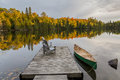 Canoe and Dock on an Autumn Lake - Ontario, Canada Royalty Free Stock Photo