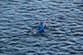 Canoe man in a blue on a lake Royalty Free Stock Image