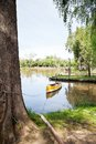 Canoe moored in lake empty against sky Royalty Free Stock Images