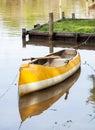 Canoe moored in lake empty calm Stock Photo