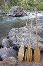 Canoe paddles and river Stock Photos