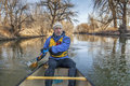Canoe paddling on Poudre River Royalty Free Stock Photography