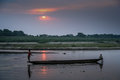 Canoe on a river two young boys crossing the in small wooden in royal chitwan national park in terai – nepalese lowlands Stock Photography