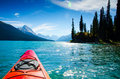 Canoe in rocky mountains Royalty Free Stock Photo