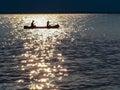 Canoe Silhouette - Sparkling Golden Ribbon Setting Sun Royalty Free Stock Photo