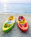 Canoes on the beach at sunlight Royalty Free Stock Photos
