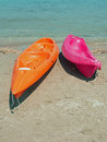 Canoes coulourfull on sandy beack Stock Photo