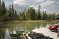 Canoes, dock and mountains at Jenny Lake, Jackson Hole, Wyoming. Royalty Free Stock Photo