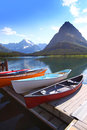Canoes by lake mc donald in glacier national park Royalty Free Stock Image