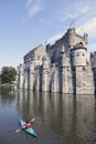 Canoes near castle gravensteen in belgium city of ghent Royalty Free Stock Photo