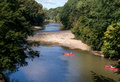 Canoes on the river people have fun paddling down at turkey run state park in indiana Stock Photos