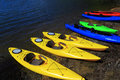 Canoes on shore summer lake or sea scene with Royalty Free Stock Photo