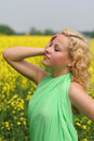 In canola field Royalty Free Stock Photos