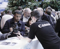 Canon customer care staff helping focus imaging expo n e c birmingham england march Royalty Free Stock Images