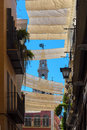 Canopies provide shade in the summer on road seville spain Stock Photos
