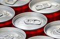 Cans of cola many aluminum red soft drink close up Stock Photography