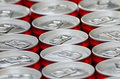 Cans of cola many aluminum red soft drink close up Royalty Free Stock Photo