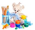 Cans of paint and teddy bear isolated Royalty Free Stock Photo