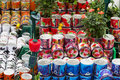 Cans with roses, souvenirs for sale at Dutch flower market, Amsterdam, Netherlands
