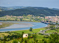 Cantabria landscape with field, river and a small town Treto. Royalty Free Stock Photo