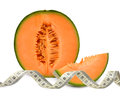 Cantaloupe melon with measuring tape Stock Photo