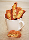 Cantuccini cookies in a coffee cup on linen fabric Royalty Free Stock Photo