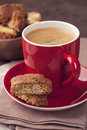 Cantuccini and a cup of coffee on brown background Royalty Free Stock Photography