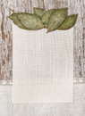 Canvas bay leaves and linen fabric on the old wood wooden background Royalty Free Stock Photos