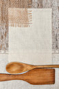 Canvas burlap and linen fabric with wooden utensils on the old background Stock Photography