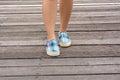 Canvas sneakers on feet on the wooden bridge