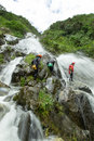 Canyoning adevnture chamana adventure team in waterfall banos de agua santa ecuador Royalty Free Stock Photography